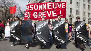 "Students carrying signs gather to protest against tuition hikes in downtown Montreal, Quebec March 22, 2012. The banner in red reads ""Maisonneuve on strike."""