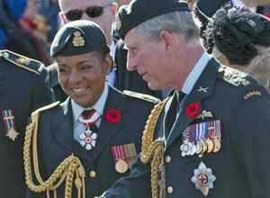 Governor-General Michaelle Jean and Prince Charles speak with veterans after a Remembrance Day ceremony in Ottawa on Wednesday, November 11, 2009.
