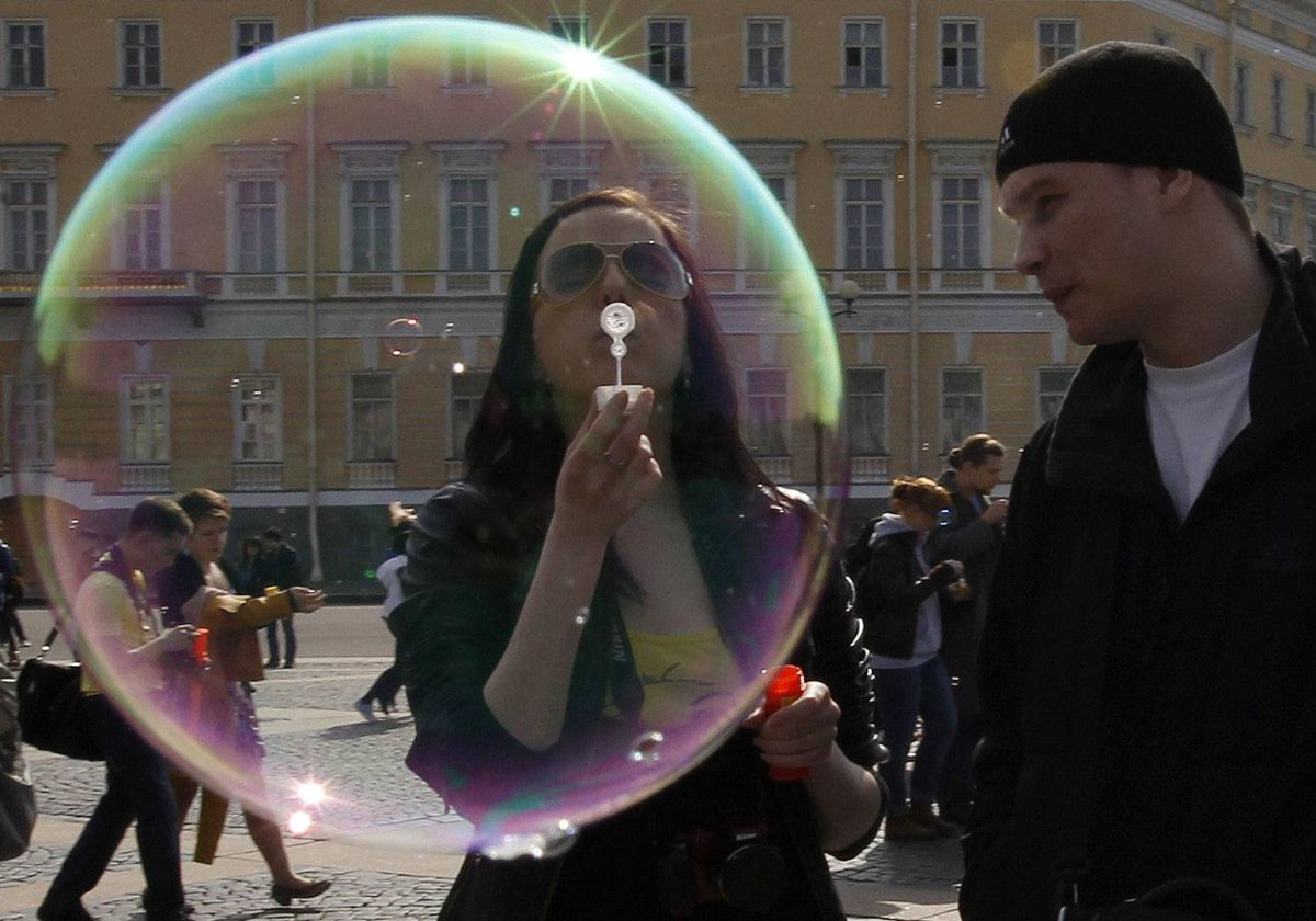 A participant takes part in a soap bubble festival in the Palace Square in St.Petersburg April 22, 2012.