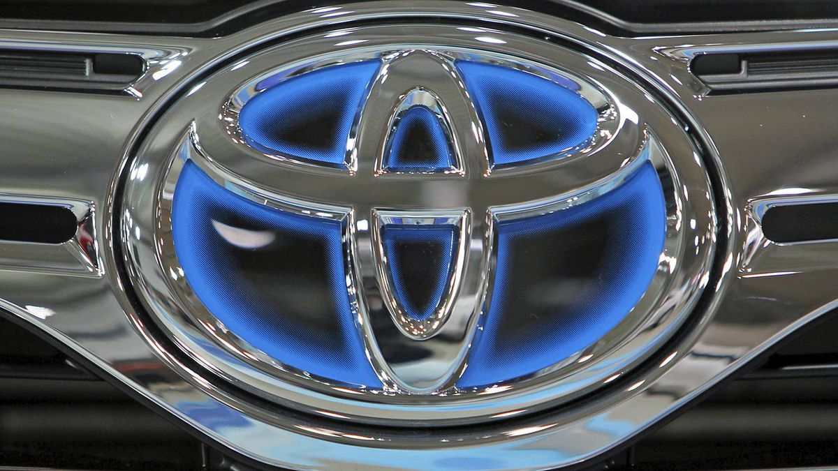 The corporate logo of Toyota Motor Corp. shines on a vehicle on display at the company's showroom in Tokyo Thursday, Nov. 10, 2011. Toyota said Wednesday it is recalling about 550,000 vehicles worldwide, mostly in the United States for problems that could make it harder to steer. (AP Photo/Junji Kurokawa)