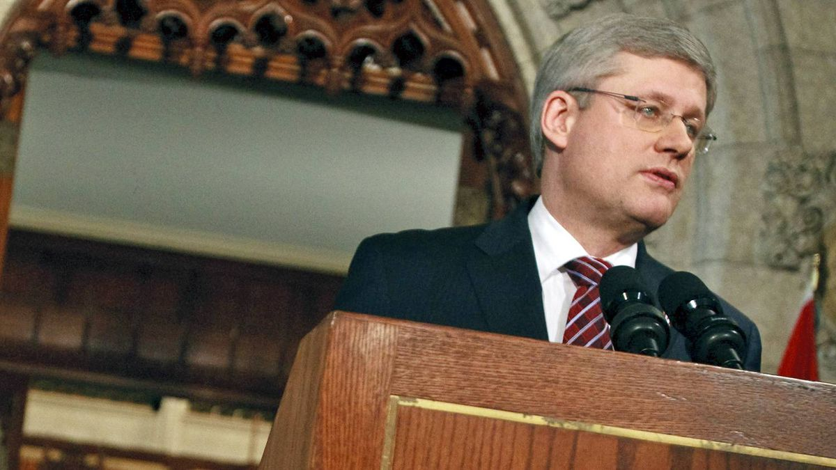 Canadian Prime Minister Stephen Harper speaks to the media at a press conference in the foyer of the House of Commons in Ottawa following the fall of his government in a no-confidence vote on March 25, 2011.