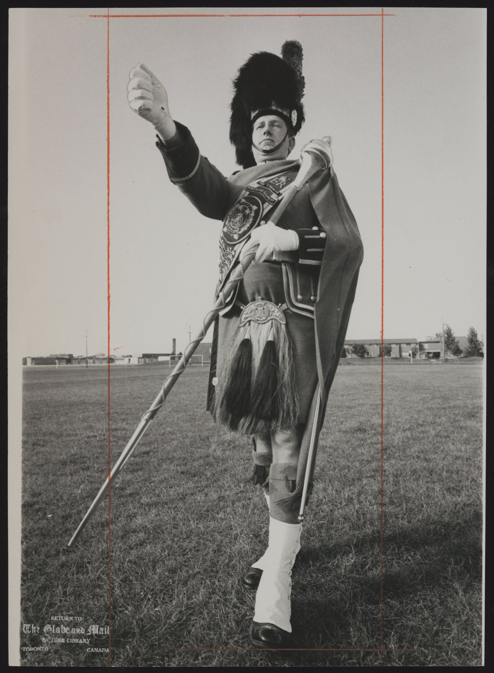 Norman (Drum Major) MacKENZIE Toronto. Drum Major Norman MacKenzie displays form that earned him the drum major's championship, with a perfect score, at Edinburgh Military Tattoo. Mr. MacKenzie, who lives in Rexdale, was drum major for a contingent representing four Canadian regiments.