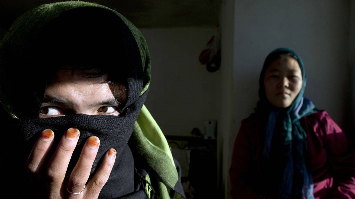 Two women are seen at a women's shelter and safe house in Bamiyan, Afghanistan. Paula Bronstein/Getty Images