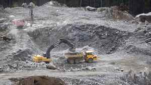 Workers clear the land at the Kitimat LNG site Sept. 28, 2011, on the Douglas Channel near the town of Kitimat, B.C.
