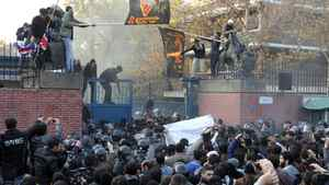 Iranian riot policemen try to prevent protesters from approaching the British embassy during a protest in Tehran on November 29, 2011. More than 20 Iranian protesters stormed the British embassy in Tehran, removing the mission's flag and ransacking offices.
