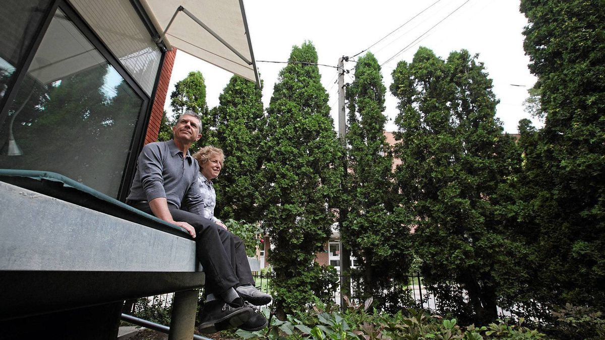 "Martin Kohn and Dufflet Rosenberg on their ""dock"" as they call in, the front porch of their new home in the Queen West and Dovercourt area of Toronto."