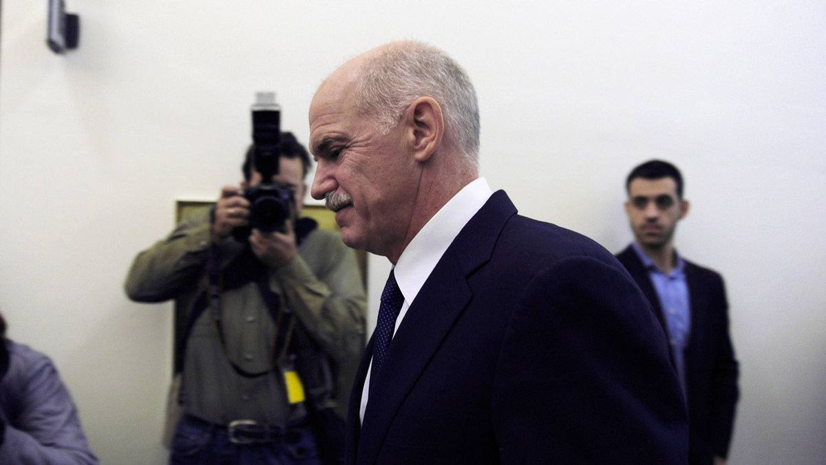 Greek Prime George Papandreou Minister walks for a cabinet meeting at the Greek Parliament on November 3, 2011 in Athens.