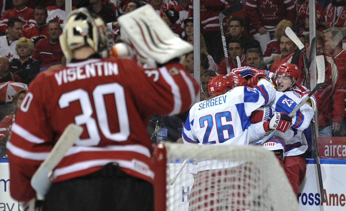 Team Canada goaltender Mark Visentin looks on as members of Team Russia celebrate a goal by Maxim Kitsyn during third period IIHF World Junior Championship gold medal final hockey action in Buffalo, N.Y. on Wednesday, January 5, 2011. Russia beat Canada 5-3.