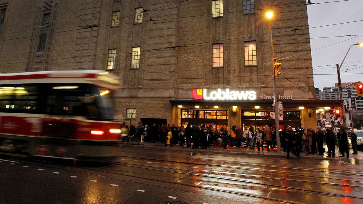Hundreds of customers lined up for hours to get an early-morning peek inside the new Loblaws store at Maple Leaf Gardens. Twenty-foot ceilings give the site, which was once the home of the Toronto Maple Leafs hockey team, a grand feeling.