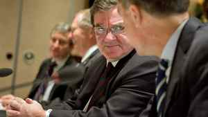 Finance Minister Jim Flaherty speaks to Bank of Canada Governor Mark Carney before meeting with his provincial and territorial and counterparts in Victoria on Dec. 19, 2011.