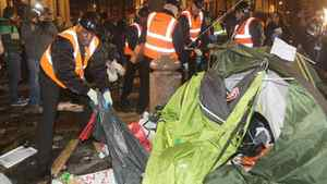 Bailiffs remove tents from the Occupy London camp.