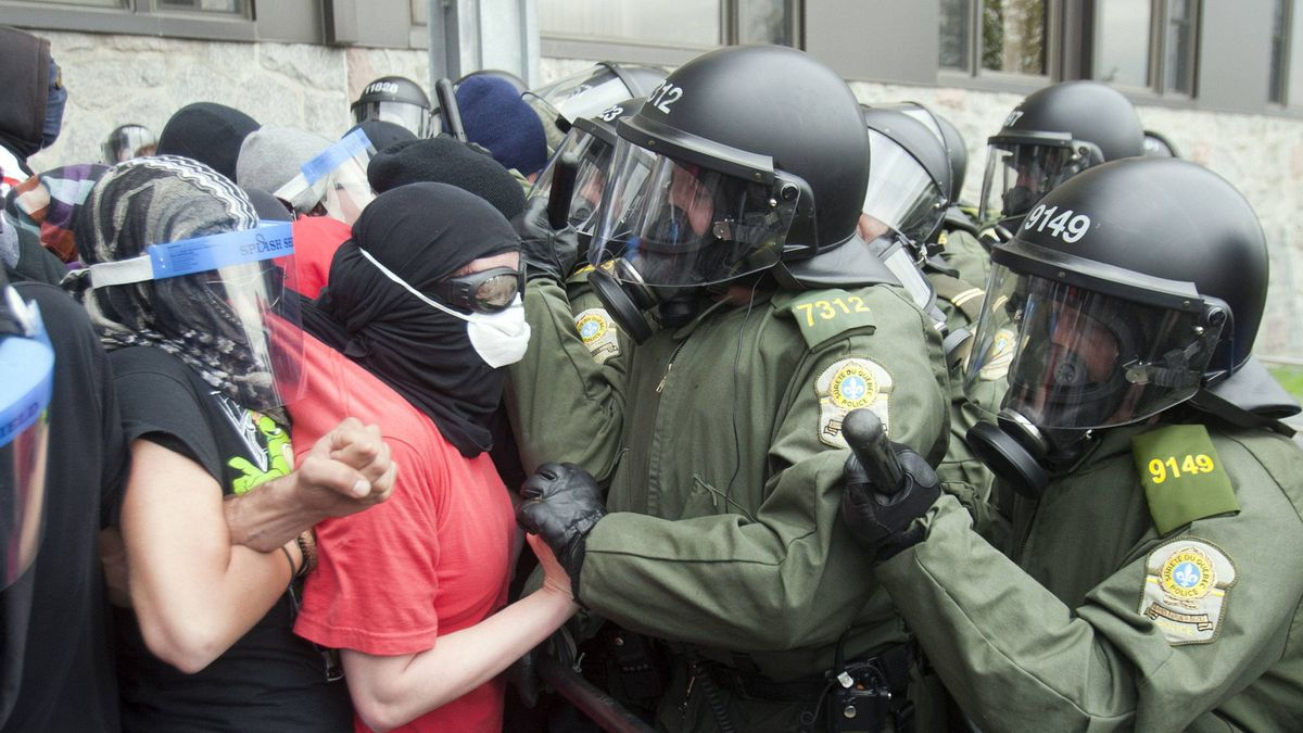 Students protesting against tuition hikes battle with Quebec Provincial Police at the Lionel Groulx college Tuesday, May 15, 2012 in Ste. Therese, Quebec.