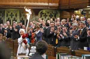 Former Olympian Barbara Ann Scott carries the torch in the House of Commons on December 10, 2009.