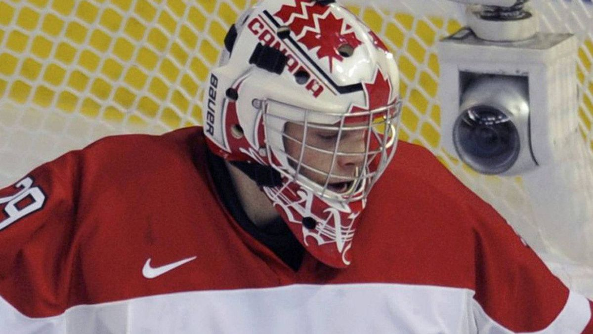 Canada's goalie Mark Visentin makes a save against Finland during the first period of play at the 2012 IIHF U20 World Junior Hockey Championships in Edmonton, Alberta, December 26, 2011. REUTERS/Dan Riedlhuber