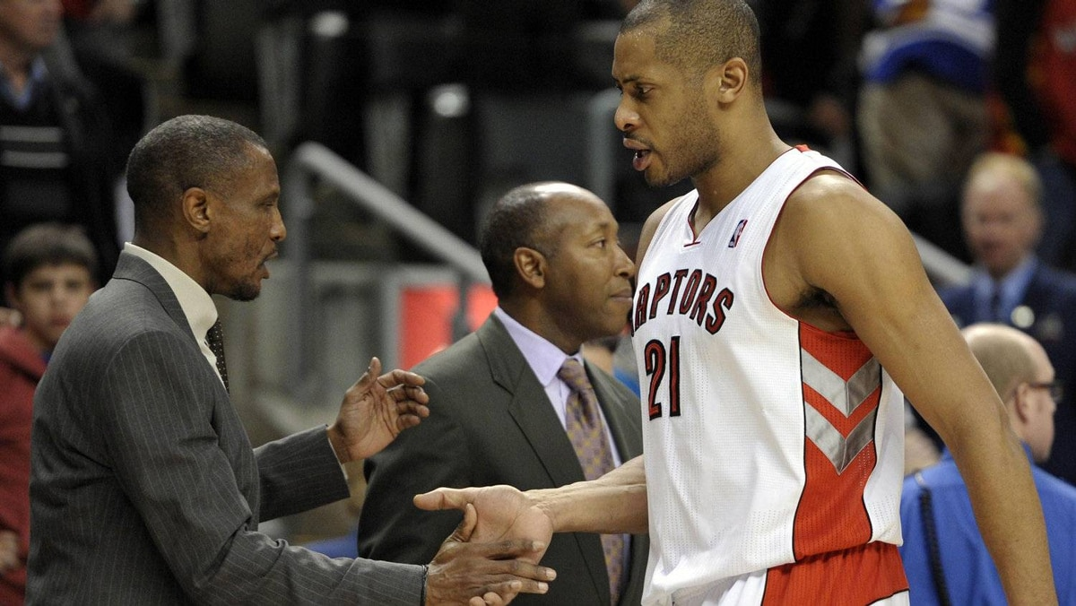 Toronto Raptors center Jamaal Magloire shakes hands with head coach Dwane Casey (L) during the second half of their NBA basketball game against the Indiana Pacers in Toronto January 13, 2012. REUTERS/Mike Cassese