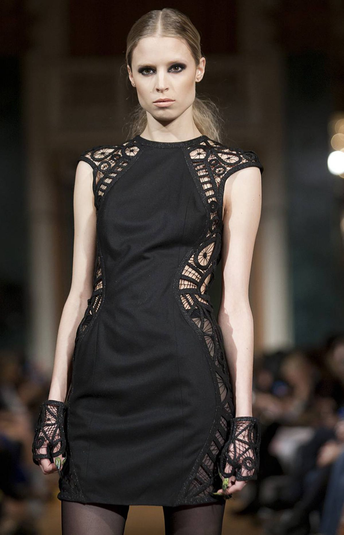 Black from start to finish – minus some rather notable jewel-toned statement nails – the Project Runway Canada alum's show offered a series of bold looks, many featuring strategic panels of peek-a-boo lace-meets-crochet detailing. Pieces for a woman who wants to be seen.