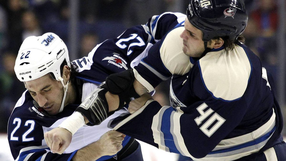 Winnipeg Jets' Chris Thorburn (L) fights with Columbus Blue Jackets' Jared Boll during the second period of their NHL hockey game in Columbus, Ohio November 12, 2011. REUTERS/Matt Sullivan