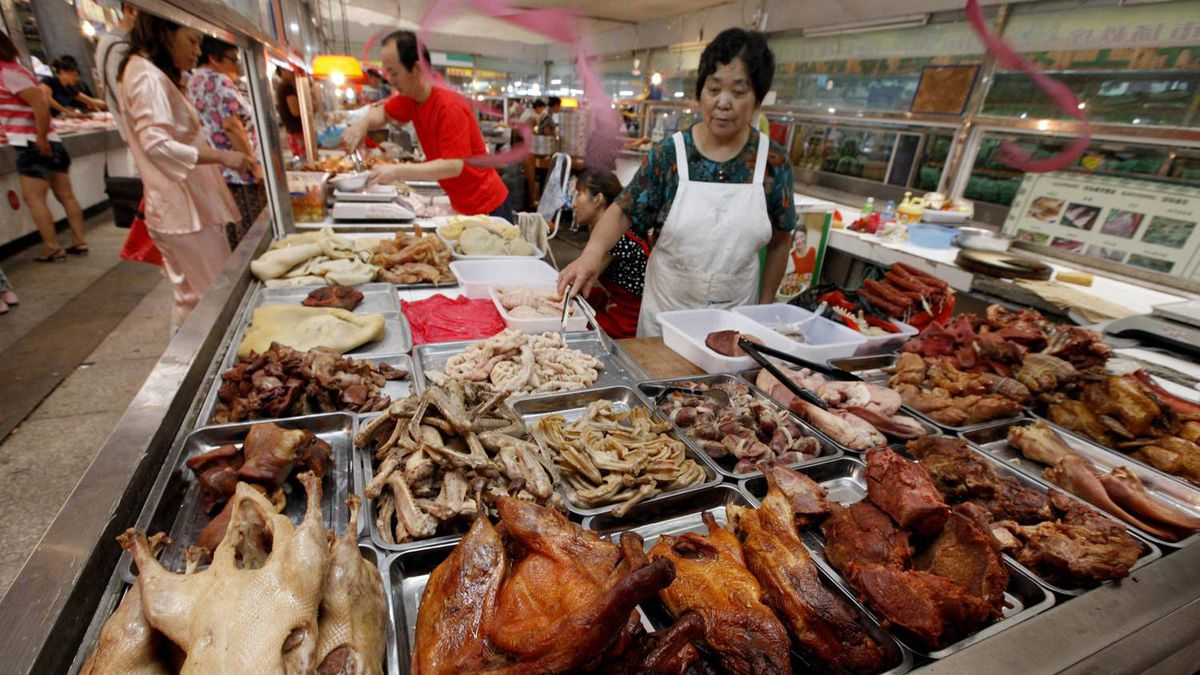 A Chinese vendor waits for customers at a food market in Hefei, east China's Anhui province.
