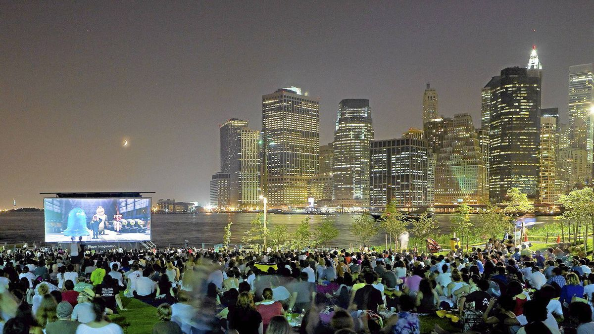 People watch the movie Monsters vs. Aliens as part of a movies-with-a-view series on Pier 1 in New York.