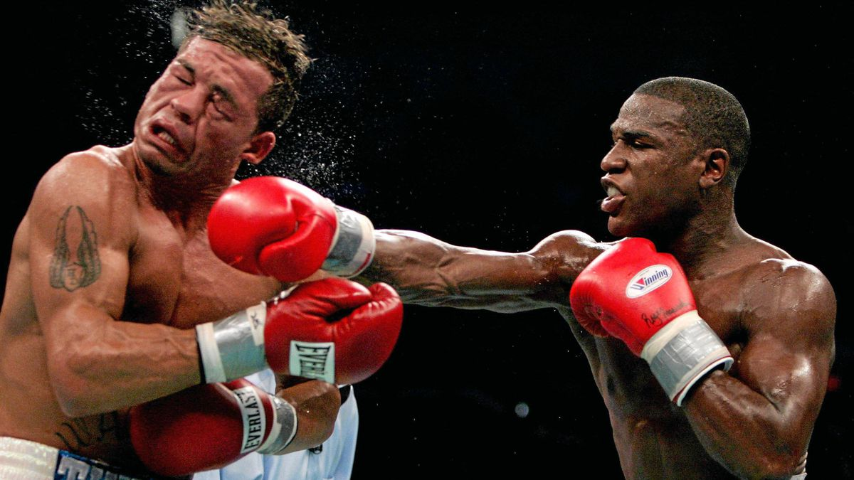 Gatti is hit by Floyd Mayweather Jr. during their WBC Super Lightweight Championship fight in Atlantic City on June 25, 2005. Mayweather won after Gatti's corner stopped the fight after the sixth round.