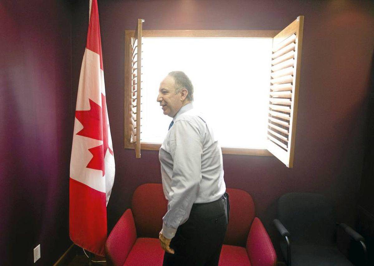 After 18 years as a Liberal MP for Vaughan, Mauricio Bevilacqua opens the shutters to his office on the last day in his constituency following his retirement announcement Thursday, September 2, 2010.