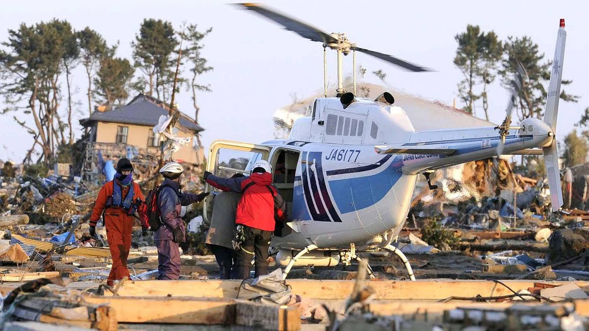 People who stayed a night at an elementary school are rescued in Sendai, Miyagi prefecture, Saturday, March 12, 2011, a day after one of Japan's strongest earthquakes ever recorded hit the country's east coast.