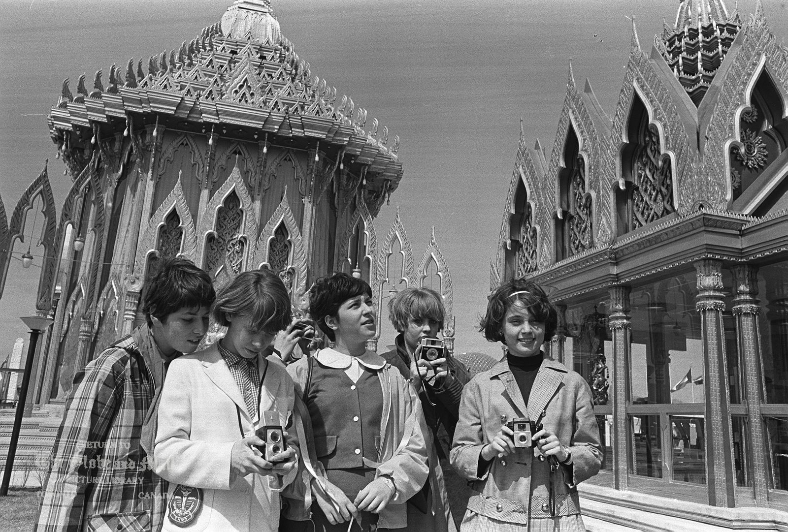April 30, 1967. The World's Fair, Expo 67, opens in Montreal to great acclaim. Students from Toronto take in all the sights and snap the odd photo or two. Photo by John McNeill / The Globe and Mail (Neg. 67121-12)