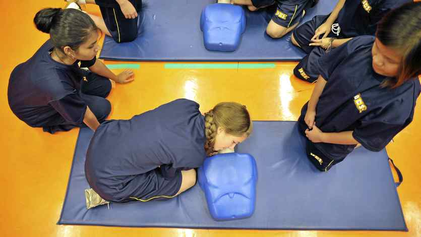 Students at Senator O'Connor College School in Toronto practise CPR.