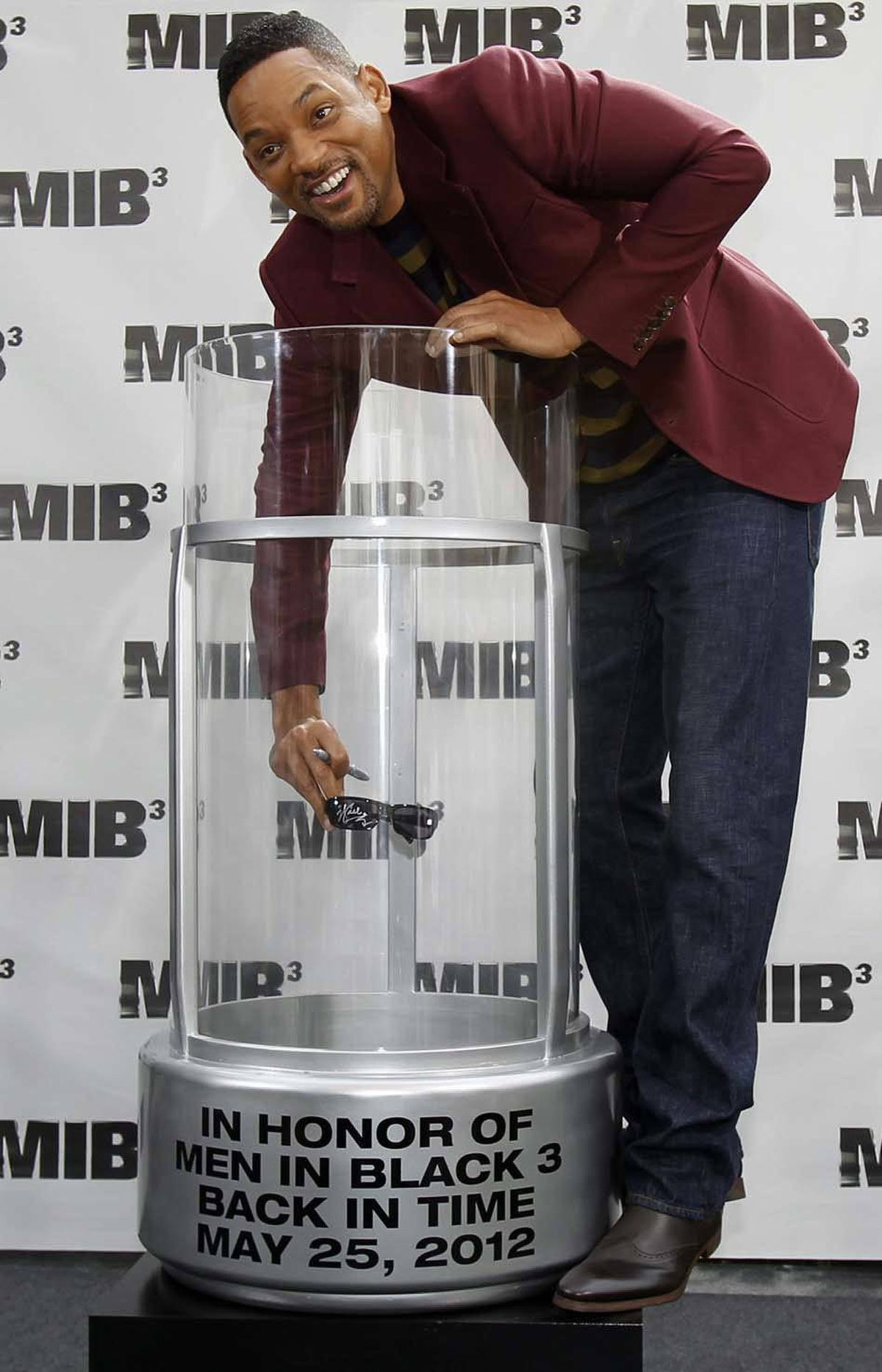 "Will Smith places a pair of autographed sunglasses in a time capsule while promoting his upcoming film ""Men in Black III"" in Los Angeles last week. Future archeologists who unearth the time capsule in 2212 will concur that it was buried during a low point in human history that was characterized by extreme narcissim. Then they will go watch ""Men in Black LXXXIII."""