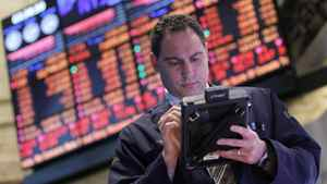 A trader works on the floor of the New York Stock Exchange, April 10, 2012.