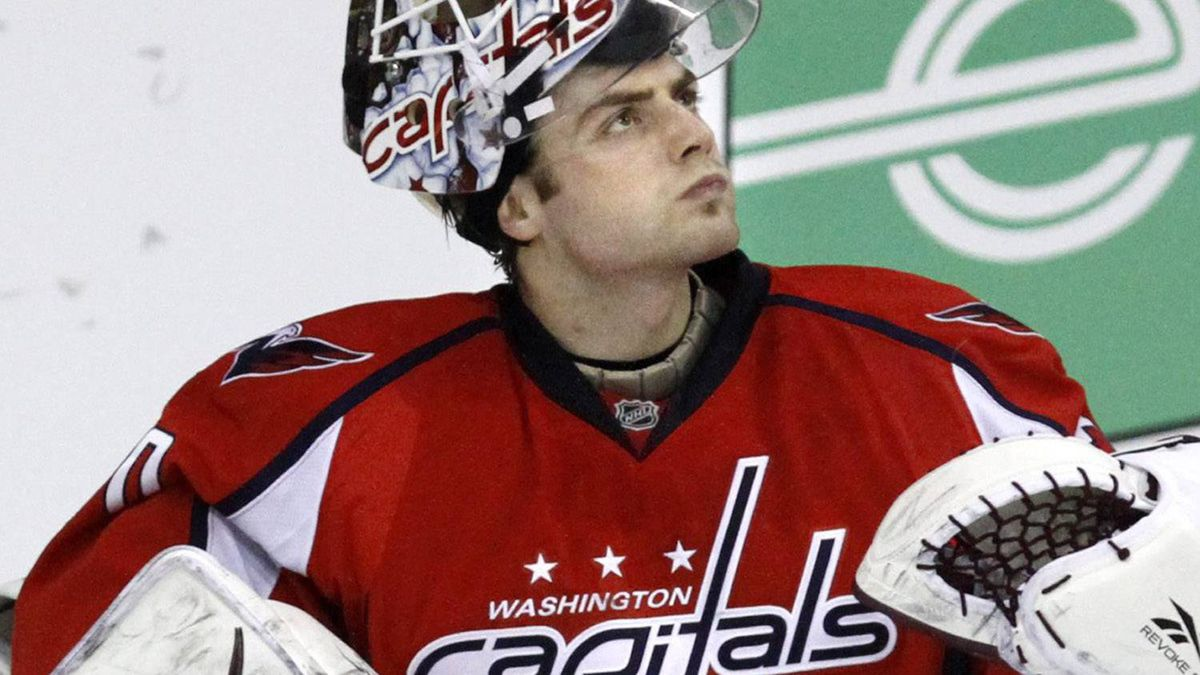 Washington Capitals goalie Braden Holtby (70) looks up at the scoreboard during a pause in play against the Chicago Blackhawks during the second period of an NHL hockey game at the Verizon Center in Washington, on Sunday, March 13, 2011. The Capitals won 4-3. Holtby, the rookie goalie, has given the Capitals a boost. He replaced an injured Michal Neuvirth after the first period in Tampa Bay on March 7, won that game plus the next three. (AP Photo/Jacquelyn Martin)