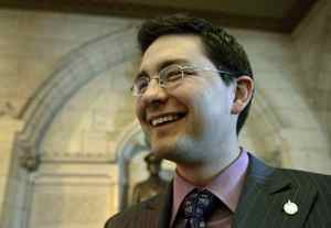 Conservative MP Pierre Poilievre laughs in the foyer of the House of Commons after Question Period on Feb. 27, 2007.