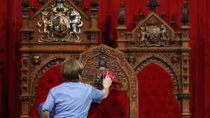 A worker cleans the Senate chamber on Parliament Hill in Ottawa on June 1, 2011.