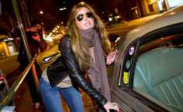 Rachel Uchitel gets into a car in front of her home in New York, Sunday, Nov. 29.