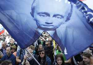 Supporters of Prime Minister and President-elect Vladimir Putin wave flags during a supporters rally in central Moscow May 6, 2012.
