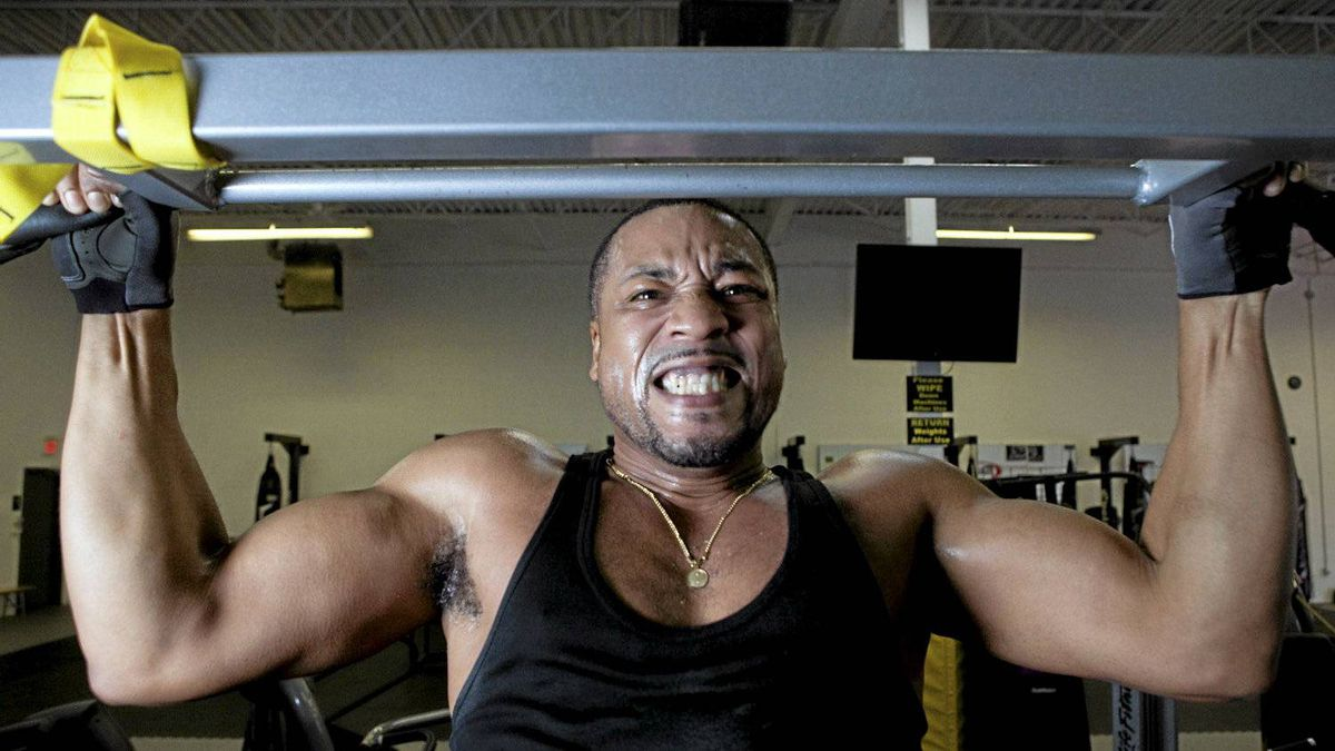 Singer-songwriter Dru does pull-ups during a workout with personal trainer Rommel Oliveros at Evolution Martial Arts Fitness Academy in Mississauga.
