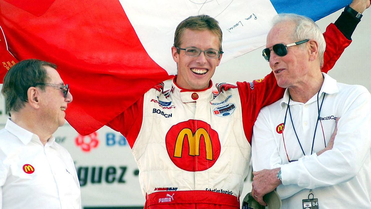 Sebastian Bourdais of France with team owners Paul Newman (R) and Carl Haas (L) of Newman/Haas Racing celebrate winning the Mexico City Grand Prix trophy at the Autodromo Hermanos Rodriguez November 7, 2004 in Mexico City, Mexico.