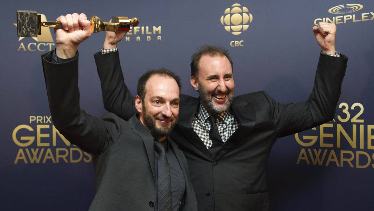 Ken Scott, left, and Martin Petit with their awards for best original screenplay for Starbuck.