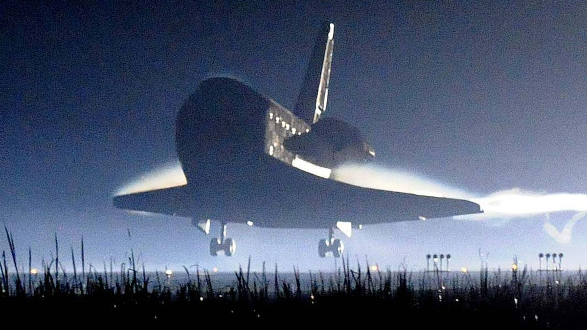 Space shuttle Atlantis lands at the Kennedy Space Center at Cape Canaveral, Florida. Thursday, July 21, 2011. The landing of Atlantis marks the end of NASA's 30 year space shuttle program.