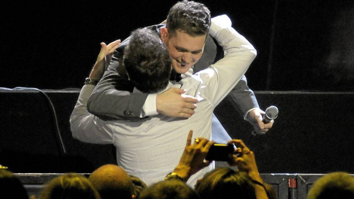 Michael Bublé hugs a member of the audience while performing at the Air Canada Centre in Toronto on Aug. 10
