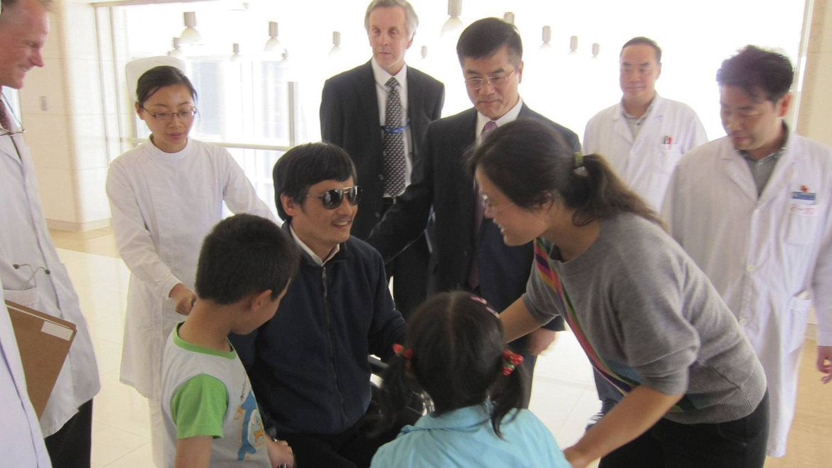 In this photo released by the U.S. embassy Beijing Press Office, blind lawyer Chen Guangcheng, in wheel chair, meets his wife Yuan Weijing, right, daughter Chen Kesi, in blue shirt at second right, and son Chen Kerui, left, at a hospital in Beijing, Wednesday, May 2, 2012.