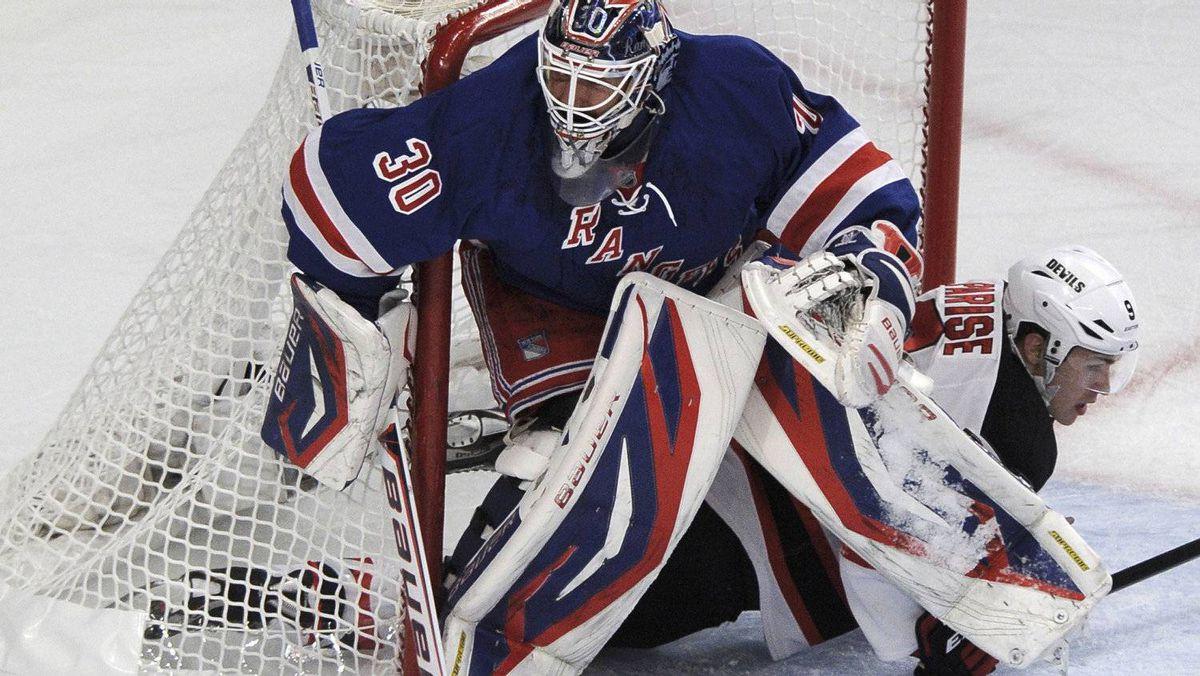 New York Rangers goalie Henrik Lundqvist and New Jersey Devils' Zach Parise (R) collide in the net . REUTERS/Ray Stubblebine