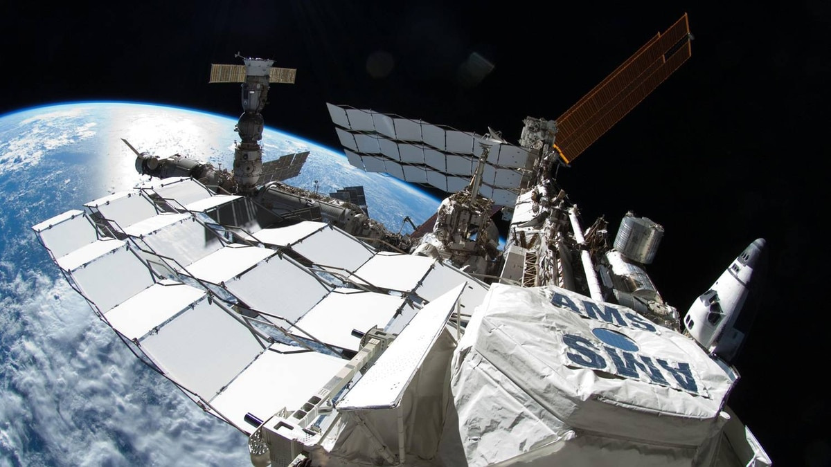 This NASA photo obtained on July 15, 2011 shows the International Space Station with Space Shuttle Atlantis on July 12, 2011 docked on the right and a Russian Soyuz on the far left. In the foreground is the Alpha Magnetic Spectrometer (AMS) experiment installed during the STS-134 mission.