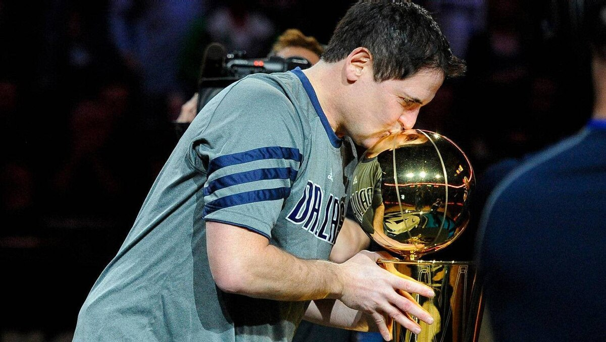 llas Mavericks owner Mark Cuban kisses the NBA trophy before the NBA championship banner is raised before the game against the Miami Heat at the American Airlines Center. Jerome Miron-US PRESSWIRE