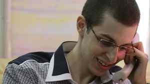Gilad Shalit speaks to his family on the telephone in this handout released by the Israeli Defense Forces (IDF) October 18, 2011
