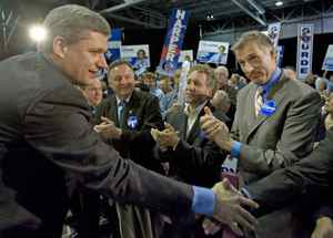 Maxime Bernier applauds Conservative Leader Stephen Harper at an election rally in Quebec City on Oct 12, 2008.