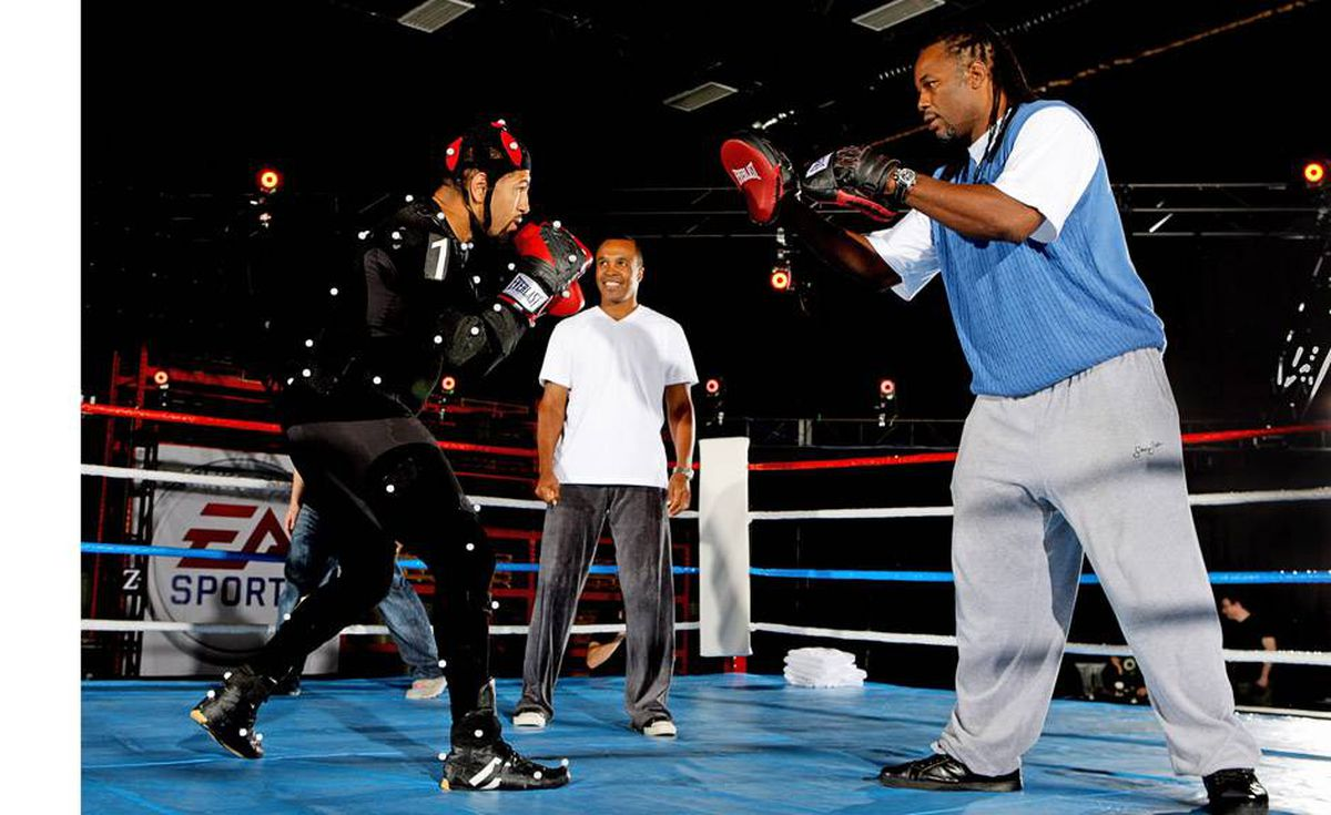 """Former boxing champions Sugar Ray Leonard (C) and Lennox Lewis (R) work out with current middleweight champion Ronald """"Winky"""" Wright during an EA Sports press event announcing that production has begun on their new video game Fight Night 4 at their studios May 7, 2008 in Burnaby, British Columbia, Canada. Wright is suited up in an outfit used to record motion capture for video games. The video game is expected to be released in 2009."""