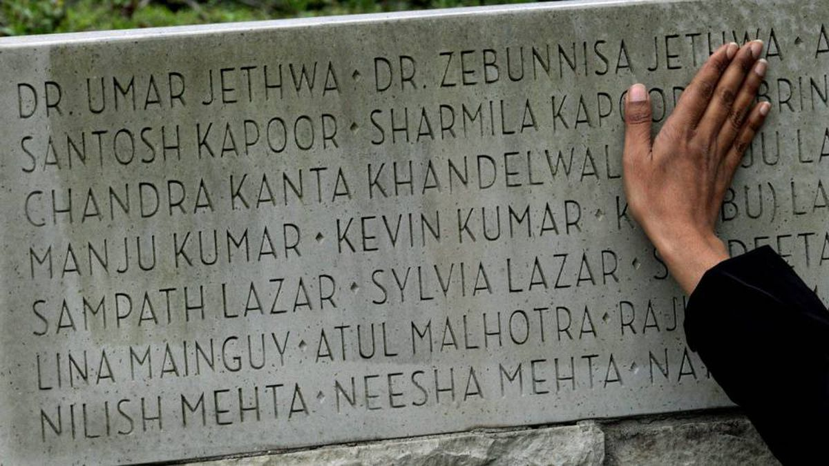 Renee Saklikar runs her hand across the names of the dead at the Air India memorial in Vancouver's Stanley Park.