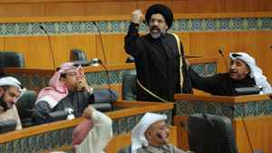 Kuwaiti Islamist-Shiite Member of Parliament Hussein Al Qallaf gesture towards opposing MP's during a heated debate over the situation in Syria in Kuwait's National Assembly's session on Wednesday, Feb. 29, 2012. A citizen of the Gulf Arab country was recently convicted of having insulted the Shi'ite faith and its scholars with comments that damaged Kuwait's image.