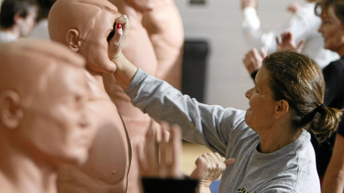 Teresa Immel, a Frontier Airlines flight attendant, practices strikes against a rubber mannequin during a crew member self-defense course provided by the Federal Air Marshals in Denver November 16, 2007.
